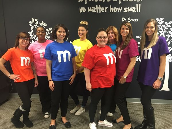 Staff all in M&Ms costumes